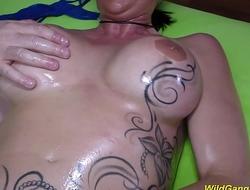 busty oiled tattooed Milf gangbanged